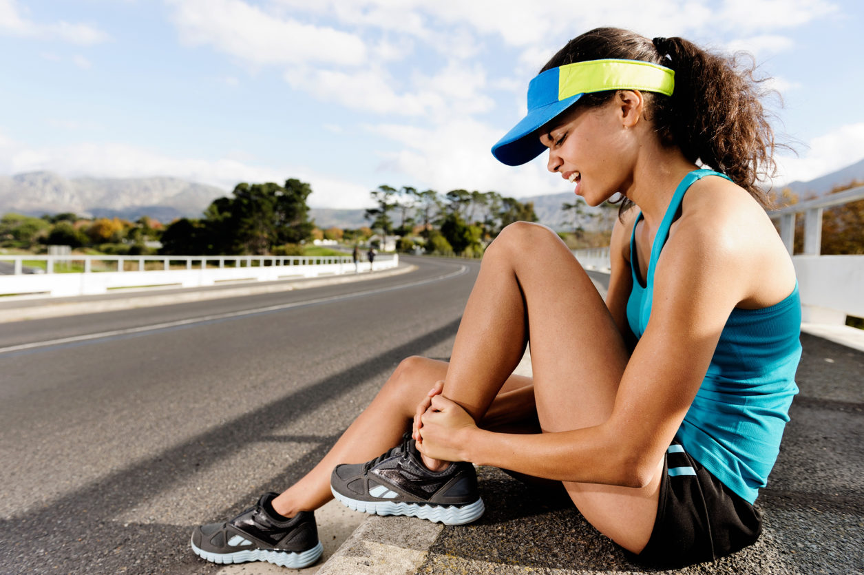Runner with ankle injury has sprained and strained ankle, painfu